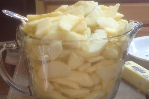 Preheat oven to 425 degrees F. Wash peel core and slice apples into thin...