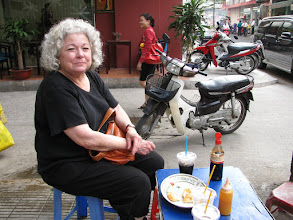 Photo: Having breakfast on a corner in Saigon
