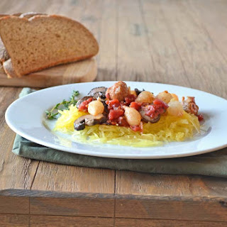 Oven Roasted Sausage with Vegetables Over Spaghetti Squash.