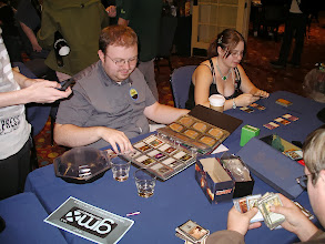 Photo: It is not an official gaming room if there isn't somebody flipping through a three ring binder of Magic cards.