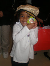 Photo: Kaleya holding a card she was giving out as we walked in the door