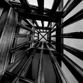 Staircase by Chris Seaton - Buildings & Architecture Architectural Detail ( wooden, architectural detail, looking up, black and white, staircase )