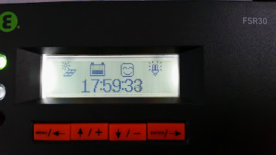 Photo: [Device replaced with a Victron unit now] Summary icon screen on the solar charge controller. Left most icon shows it is daytime and solar array is generating energy