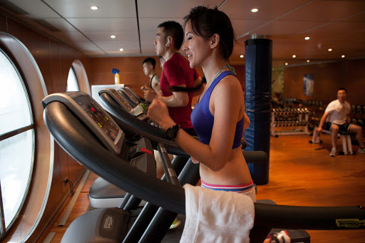Using the treadmill in the gym on Costa Victoria from Costa Cruises.