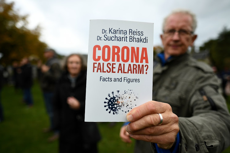 Protesters with placards gather outside the Scottish Parliament entrance to demonstrate against new coronavirus restrictions, face covering rules and the search for a virus over the weekend in Edinburgh, Scotland. Picture: Jeff J Mitchell/Getty Images