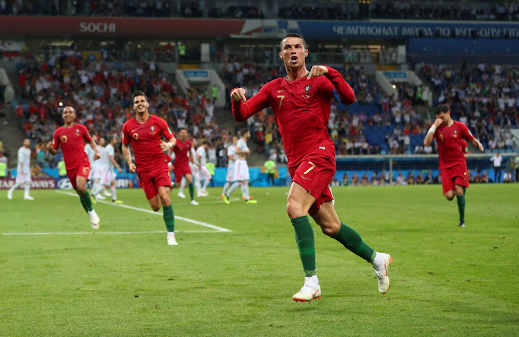 5588b969526 Portugal s Ronaldo scores World Cup hat-trick against Spain