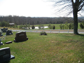 Photo: The road past the Webb Cemetery is a dead end, leading to the farm owned by Raymond Coonce and his wife. The farm had several ponds used by his cattle. The view looks south toward Vienna, and on the far ridge is I-24, the route to Paducah, KY.