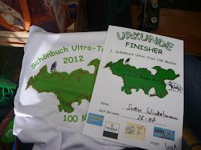 Photo: Urkunde und Shirt für einen stolzen Finisher :-)