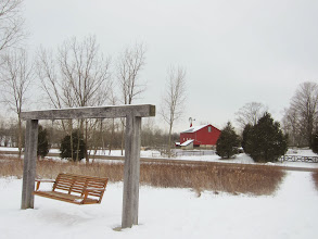 Photo: Wood swing and red barn and windmill in snow at Carriage Hill Metropark in Dayton, Ohio.