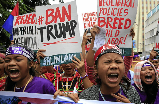 High emotions: Protesters shout anti-US government slogans during a protest outside the US embassy in the Philippines on Thursday. Picture: REUTERS