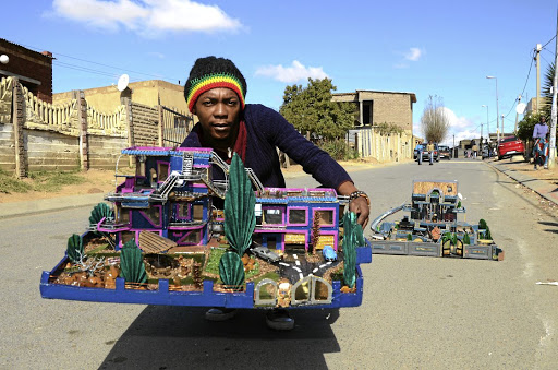 Mveliso Ntaba is an artist that recycles cardboard and plastic to make architectural structures.
