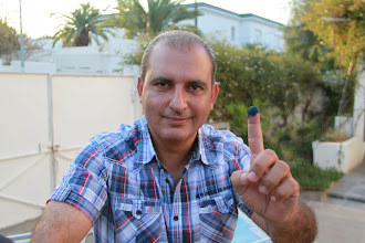 Photo: Just voted, Karim shows his index finger dipped in ink.