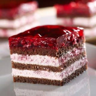 Jello Topping Chocolate Cake Filled With Raspberry Cream.