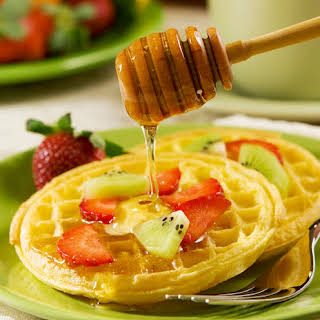 Waffles With Fruit And Honey Sauce.