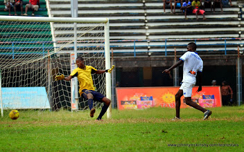Photo: Kabba Tucker shoots for the Leone Stars [Training game against u-20 National team, ahead of Leone Stars v Seychelles Game in Freetown on 19 July 2014 (Pic: Darren McKinstry)]