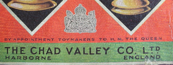 """Photo: Royal Warrant affixed to label of a Chad Valley plastic chess set (CH319: probably late 1940's / early 1950's).  The Royal Warrant was granted to the company on 4 May 1938 by Queen Elizabeth, the mother of our present Queen.  As it still refers to her as 'The Queen' it must pre-date the accession in 1953, when the wording was changed to read """"..Toymakers to Queen Elizabeth The Queen Mother"""".   According to the Royal Archives, they cannot now determine whether the Warrant was granted for a particular product, but it is likely that is was granted for the general supply over a number of years. The CV Warant appears to have been regularly renewed - """"...every year as well as upon any change in the Chairmanship of the company. The Warrant was eventually cancelled in 1978.""""  As I haven't seen the post 1953  wording on a CV chess set, it seems that these ceased prior to 1953.     More information on Royal Warrants, generally, can be found here:  http://www.royal.gov.uk/MonarchUK/Symbols/Royalwarrants.aspx"""