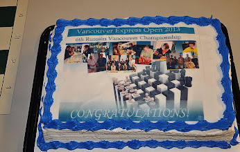 Photo: Chess Cake decorated by pictures from all 5 previous Championships