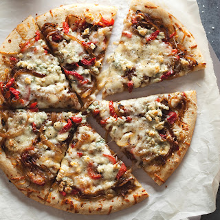 Three-Cheese Pizza with Caramelized Onions and Pimientos.