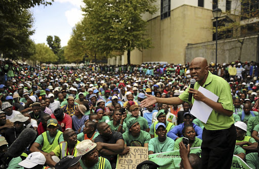 Rough reality: Association of Mineworkers and Construction Union president Joseph Mathunjwa addresses striking mine workers in this file picture. He now says more retrenchments are looming and blames challenges in the industry on SA's leadership, who are 'caught up in selfish interests'.Picture: REUTERS