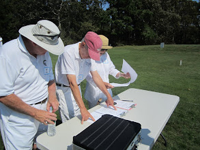 Photo: Bill, Bob and Jane at registration table:  Who plays with who?