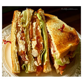 Slow Roasted Chicken Club with Bacon, Swiss & Honey Mustard Sauce.