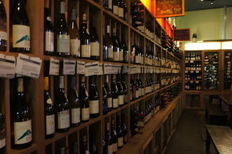 Photo: The wines line the walls of this large but quaint wine bar.