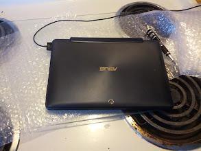 Photo: Fixing Kayla's tablet