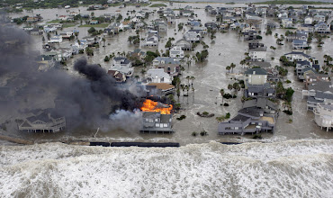 Photo: Fire destroys homes along the beach on Galveston Island, Texas as Hurricane Ike approaches Friday, Sept. 12, 2008. (AP Photo/David J. Phillip).  Bodies in warm climates are usually reduced to skeletons in only a few weeks and special analysis is required for identification.