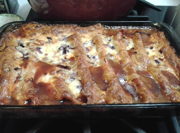 When enchiladas are done, carefully remove them from baking dish with a long spatula....