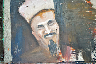 Photo: A graffiti painting of Sheikh Emad Effat of Al Azhar mosque on the side of the 'Mugama' government building.