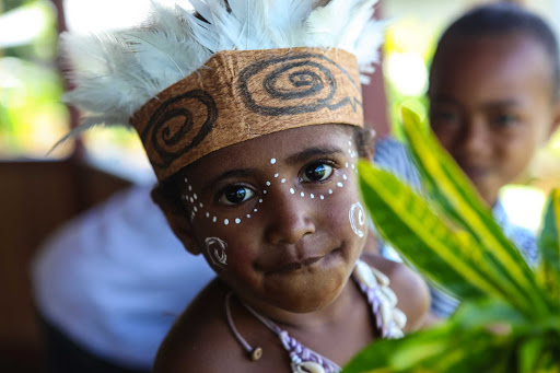 Ponant-Papua-New-Guinea-child.jpg - Discover the culture of Papua New Guinea on a Ponant cruise.