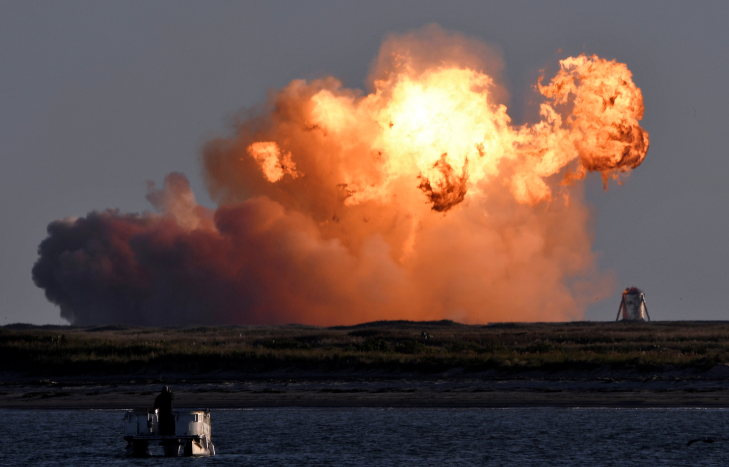 SpaceX's first super heavy-lift Starship SN8 rocket explodes during a return-landing attempt after it launched from their facility on a test flight in Boca Chica, Texas on US on December 9 2020.
