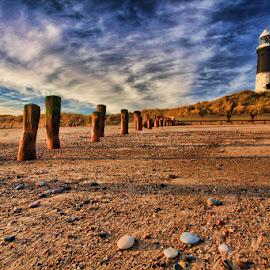 Lighthouse at Spurn Point by Steve BB - Nature Up Close Sand ( clouds, sand, spurn point, cold, groynes, blue, sunset, lighthouse, pebbles, beach, golden, shadows, landscape )