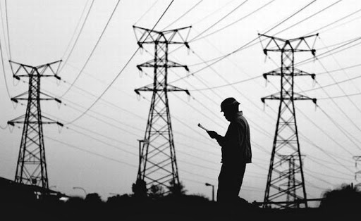 An Eskom worker checks power lines. Picture: MARIANNE SCHWANKHART