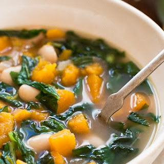 BUTTERNUT SQUASH SOUP WITH CANNELLINI BEANS + GREENS.