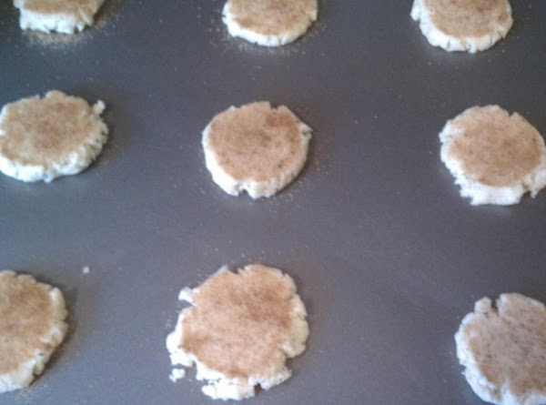 Drop dough onto cookie sheet.  Combine cinnamon and sugar; dip bottom of a...