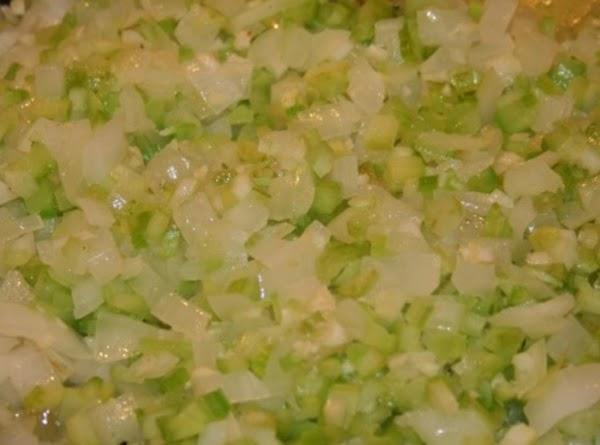 Melt butter in skillet; saute' onion and celery until tender.