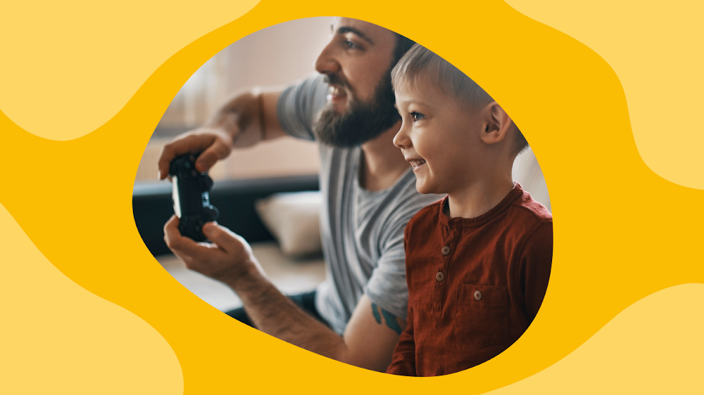 man and young boy play a video game