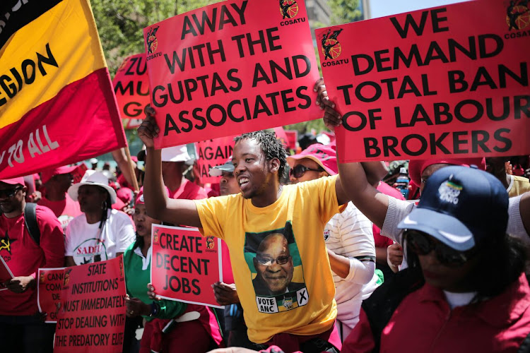 Members of Cosatu and its affiliated unions gather outside Cosatu House in Braamfontein. Picture: Alaister Russell