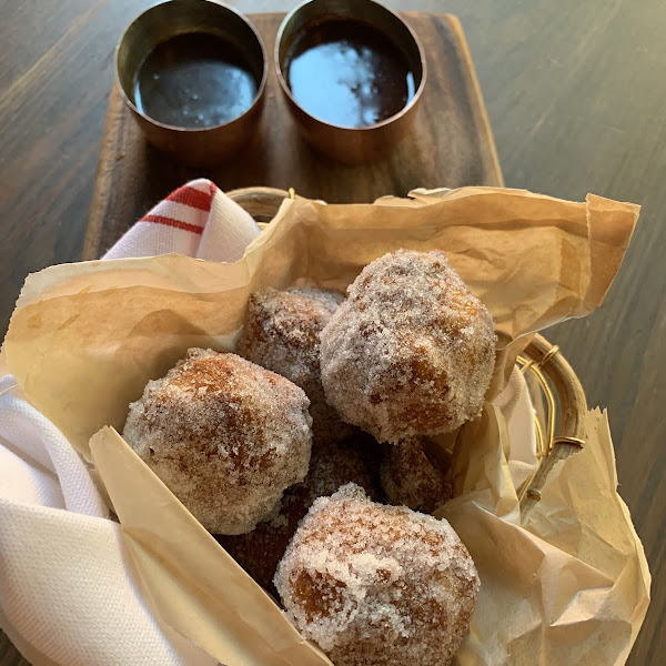 Raised gluten free donuts with chocolate and caramel dipping sauces