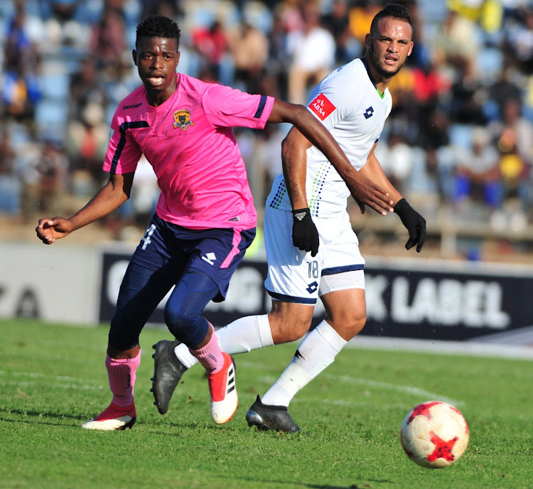Black Leopards player Phathutshedzo Nange, left, in action during the National First Division promotion-relegation playoff against Platinum Stars at the Thohoyandou Stadium yesterday