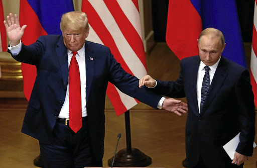 US President Donald Trump and Russian President Vladimir Putin at a joint news conference after their meeting in Helsinki, Finland, on July 16 2018. Picture: REUTERS/LEONHARD FOEGER