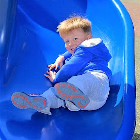 Slide Smile by Don Cailler - Babies & Children Toddlers ( blue, slide, toddler, boy )