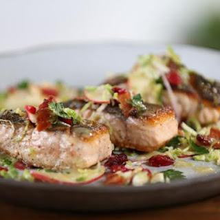 Seared Salmon and Brussels Sprout-Apple Salad with Bacon and Maple-Thyme Vinaigrette.