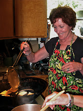 Photo: Peggy frying rice squares 1