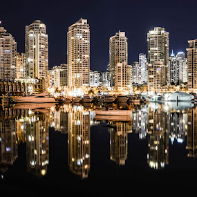 Waterfront mirror by Cory Bohnenkamp - City,  Street & Park  Skylines ( water, mirrored reflections, skyline, buildings, reflections, night, city )