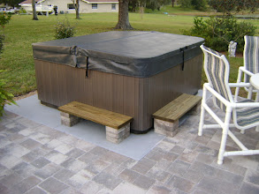 Photo: I had planned on installing the spa out in the lawn on the EZ Pad, however, my wife suggested that she would really be more happy with installing the spa with a patio surrounding it. Concrete was not an option, since it would have been ugly. We decided on a paver stone patio, and installed the spa in one corner on the EZ pad. Installing the EZ pad was a piece of cake, and the whole area looks great.  James C, Inverness, Fl