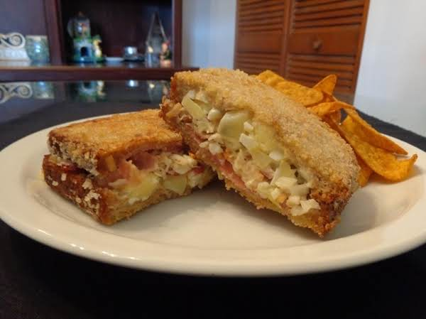 Potato Salad, Cole Slaw And Bacon Sandwich. Dip In Egg Wash And Coat With Panko Then Deep-fry Until Golden And Crisp.