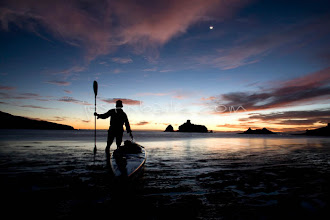 Photo: Young male kayaker at twilight on the Sea of Cortez, Mexico.