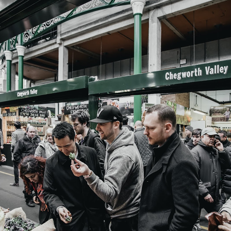 Dave Wong and Ryan Stone, members of the Earls Chef Collective and Beverage Director, Cam Bogue in London at an open-air market.